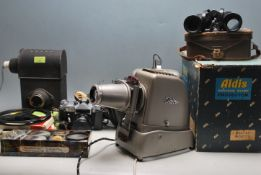VINTAGE 20TH CENTURY SLIDE PROJECTOR AND 16MM FILM PROJECTOR
