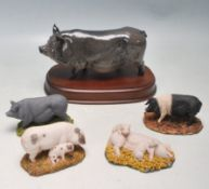 COLLECTION OF FIVE ROYAL DOULTON PIGS