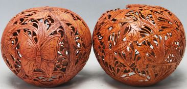 TWO VINTAGE 20TH CENTURY PIERCED AND CARVED EXOTIC NUTS