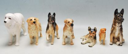 COLLECTION OF LATE 20TH CENTURY CERAMIC DOG FIGURINES