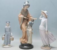THREE VINTAGE LATE 20TH CENTURY PORCELAIN FIGURINES BY LLADRO AND NAO