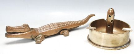 LARGE BRASS CROCODILE NUT CRACKER AND A LARGE WWII TRENCH ART ASHTRAY