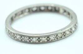 VINTAGE 18CT WHITE GOLD AND DIAMOND ETERNITY RING