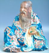 19TH CENTURY CHINESE GLAZED FIGURE OF A SEATED ELDER