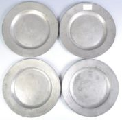 FOUR 18TH CENTURY GEORGIAN PEWTER CHARGER PLATES