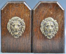 PAIR OF 19TH CENTURY OAK ARTS AND CRAFTS LION FACE BOOKENDS