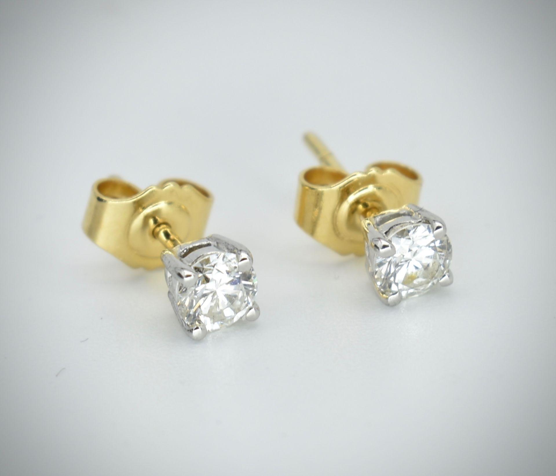 Pair of 18ct Gold & Diamond Stud Earrings