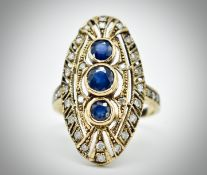 A 9ct Yellow Gold Sapphire & Diamond Navette Ring