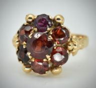 An 18ct Gold & Garnet Cluster Ring