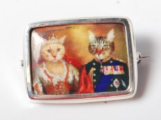 VINTAGE STYLE WHITE METAL BROOCH OF RECTANGULAR FORM WITH ROYAL CATS
