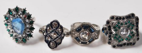 GROUP OF FOUR ART DECO STYLE DRESS RINGS