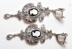 PAIR OF RENAISSANCE STYLE WHITE METAL EARRINGS