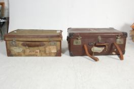 PAIR OF VINTAGE 20TH CENTURY LEATHER AND CANVAS TRUNKS.