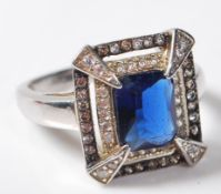 LARGE .925 LADIES DRESS RING HAVING A LARGE CENTRAL BLUE STONE