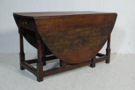 19TH CENTURY GEORGIAN OAK GATE LEG TABLE