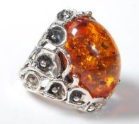 A 925 SILVER AND FAUX AMBER ART NOUVEAU STYLE DRESS RING