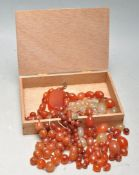 GROUP OF MIXED CARNELIAN BEADS AND SPARES