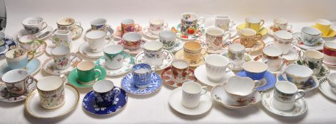 LARGE QUANTITY OF CERAMIC AND PORCELAIN CABINET CUPS AND SAUCERS