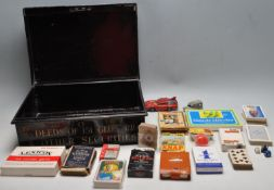 20TH CENTURY BLACK METAL BRISTOL DEEDS BOX FILLED WITH VINTAGE PARLOUR GAMES AND PLAYING CARDS