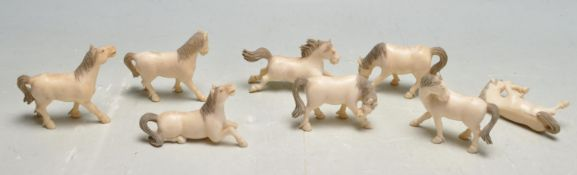 COLLECTION OF EIGHT EARLY 20TH CENTURY CARVED BONE HORSES