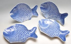 SET OF FOUR BLUE AND WHITE CHINESE FISH PLATES