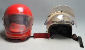 TWO VINTAGE 20TH CENTURY MOTORCYCLE HELMETS