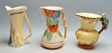 COLLECTION OF THREE ART DECO EARLY 20TH CENTURY JUGS