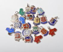 GROUP OF TWENTY SILVER SOUVENIR CHARMS
