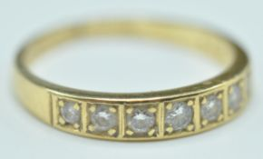 18CT GOLD & DIAMOND HALLMARKED SEVEN STONE RING