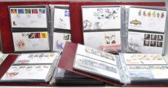 FOUR ALBUMS OF ROYAL MAIL FIRST DAY COVERS