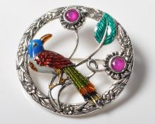 STAMPED .925 STERLING SILVER BROOCH WITH ENAMEL DECORATED BIRD TO THE CENTRE