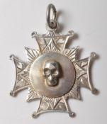 19TH CENTURY VICTORIAN STERLING SILVER SKULL FOB MEDAL.