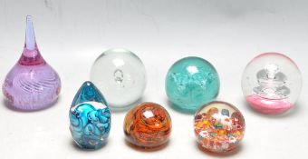 GROUP OF VINTAGE GLASS PAPERWEIGHTS