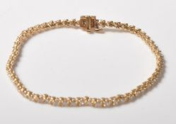 14CT GOLD DIAMOND SET BRACELET