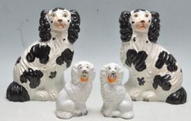 TWO PAIRS OF CERAMIC ANTIQUE STAFFORDSHIRE SPANIEL DOGS