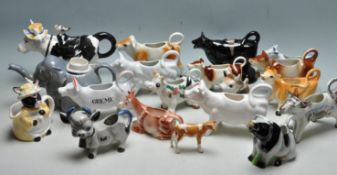 LARGE QUANTITY OF VINTAGE RETRO CERAMIC CREAMER JUGS IN A FORM OF COWS