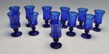 TWELVE HAND BLOWN BRISTOL BLUE WINE GLASSES