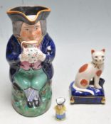 ANTIQUE HAND PAINTED TOBY JUG TOGETHER WITH AN UNUSUAL MINIATURE TOBY JUG