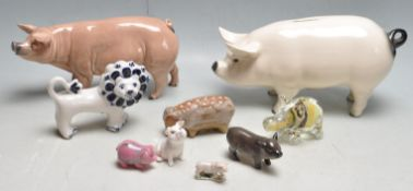 COLLECTION OF CHINA POTTERY AND GLASS PIG FIGURINE ORNAMENTS