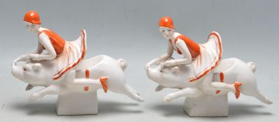 A pair of vintage style Art Deco revival ceramic bookends having two flapper girls riding pigs.