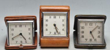 SET OF THREE VINTAGE 1950S MID 20TH CENTURY LEATHER BOUND TRAVEL CLOCK
