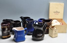 LARGE COLLECTION OF VINTAGE PROMOTIONAL ADVERTISING CERAMIC WHISKY JUGS