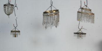 COLLECTION OF THREE EARLY 20TH CENTURY BRASS CHANDELIERS