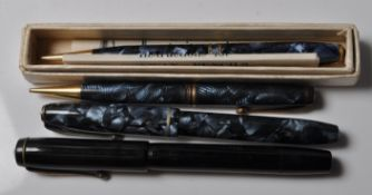 FOUR VINTAGE CONWAY FOUNTAIN PENS AND PENCILS