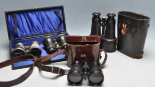 GROUP OF FOUR 19TH AND 20TH CENTURY BINOCULARS