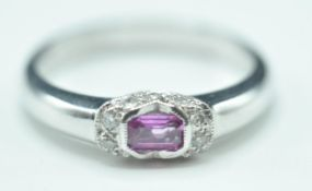9CT WHITE GOLD AND PINK STONE RING