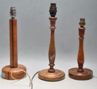 THREE VINTAGE 20TH CENTURY TEAK WOOD DESK LAMP BASES