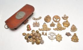 GROUP OF FIRST AND SECOND WORD WAR CAP BADGES
