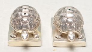 PAIR OF STAMPED .925 SILVER PLATE TORTOISE SALT AND PEPPER