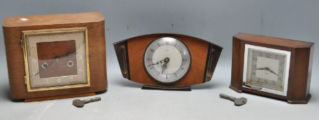 THREE RETRO 1960S MANTLE CLOCKS BY METAMEC AND SMITHS.